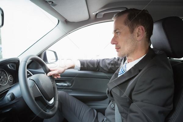 Handsome businessman in the drivers seat Stock photo © wavebreak_media