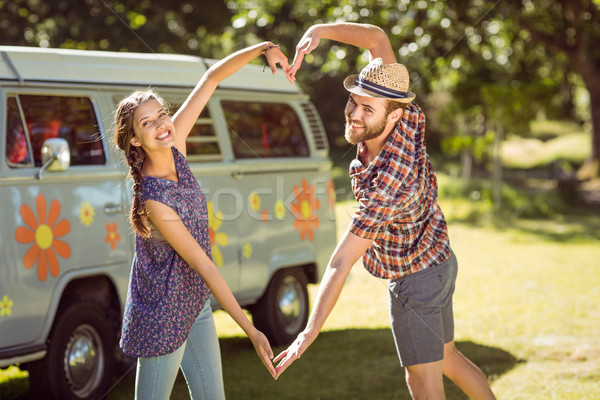 Hipster couple making heart with arms Stock photo © wavebreak_media