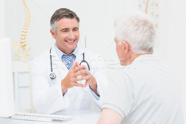Orthopedic doctor discussing with senior patient Stock photo © wavebreak_media