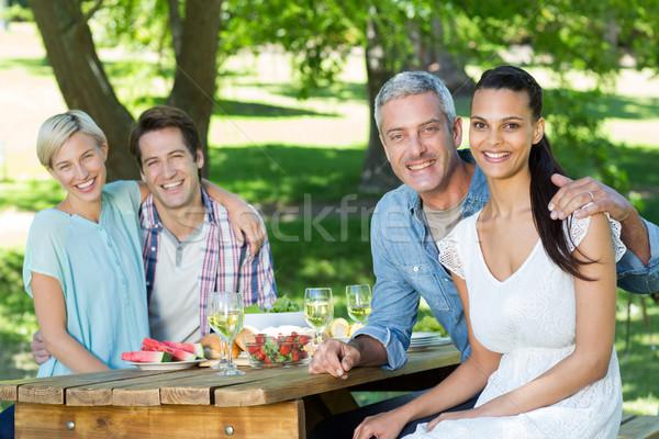 Happy couples smiling at the camera  Stock photo © wavebreak_media