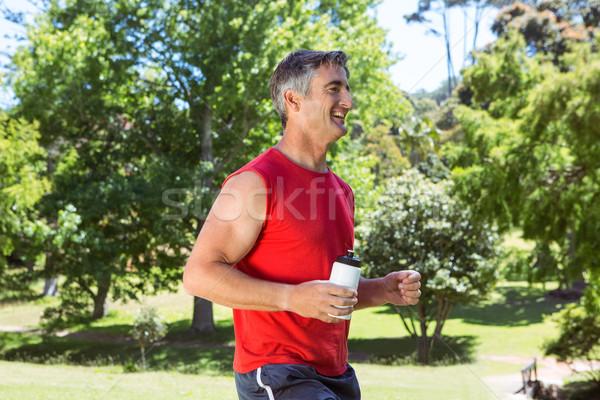 Dopasować człowiek jogging parku drzewo Zdjęcia stock © wavebreak_media