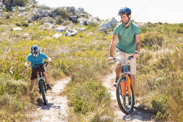 Father and son biking through mountains Stock photo © wavebreak_media