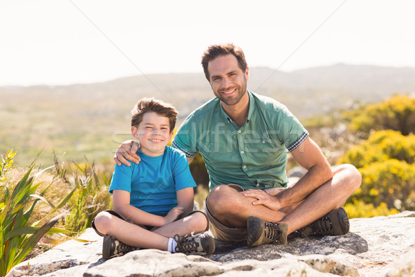 Father and son hiking through mountains Stock photo © wavebreak_media