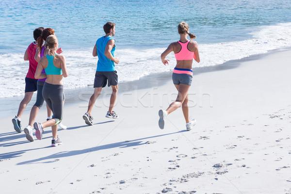 Vrienden jogging samen strand vrouw voorjaar Stockfoto © wavebreak_media