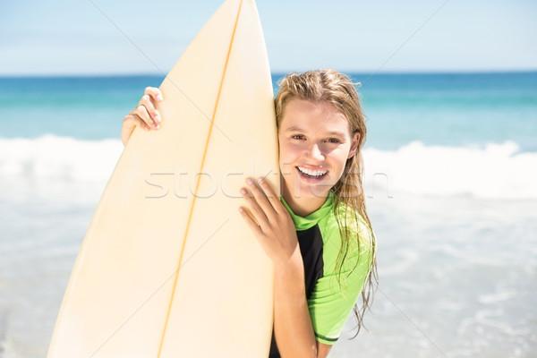 Csinos szőke nő tart szörf tábla tengerpart Stock fotó © wavebreak_media