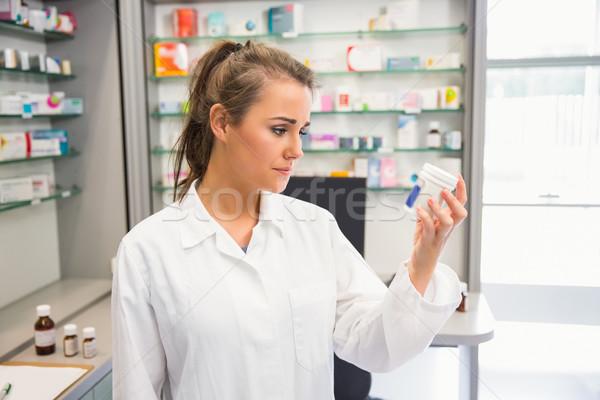 Junior pharmacist looking at medicine Stock photo © wavebreak_media