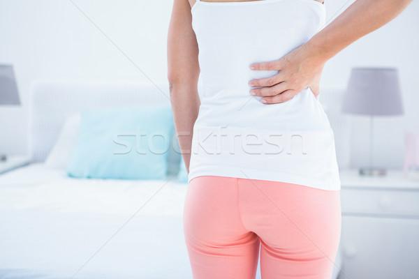 Nő hátfájás otthon hálószoba test női Stock fotó © wavebreak_media