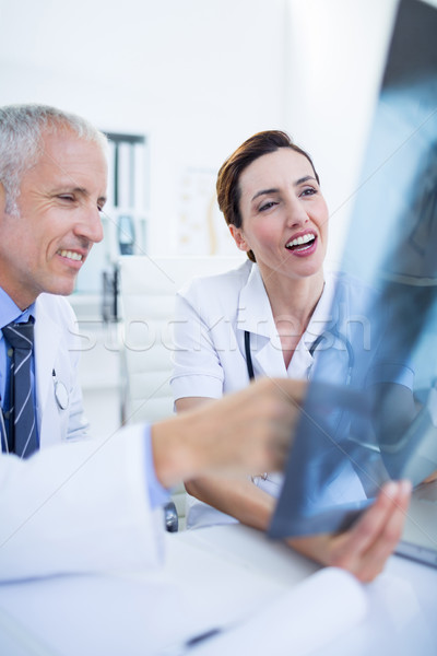 Smiling medical colleagues examining x-ray together Stock photo © wavebreak_media