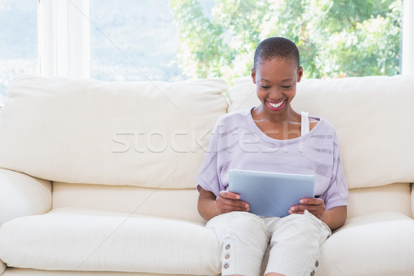 Happy smiling woman using digital tablet on couch  Stock photo © wavebreak_media