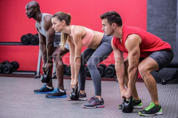 Three young Bodybuilders doing weightlifting Stock photo © wavebreak_media