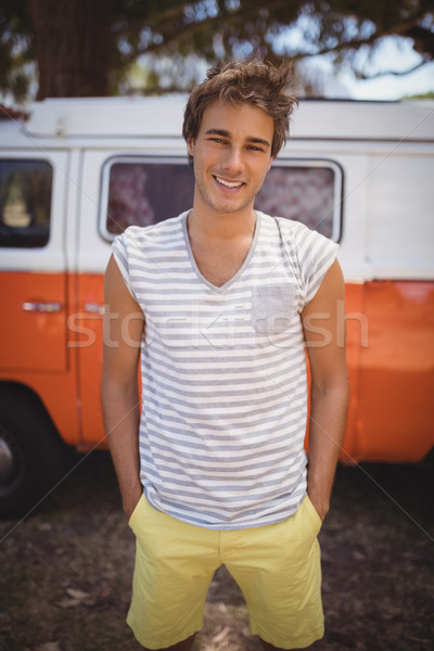 Portrait of smiling man standing against van Stock photo © wavebreak_media