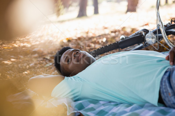 Stock photo: Young man relaxing on a picnic blanket