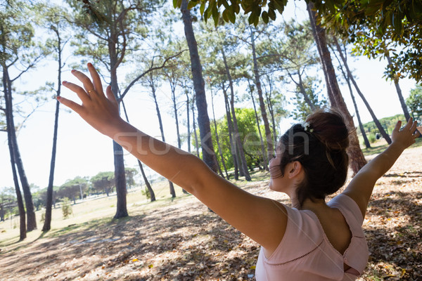 Woman standing with arms outstretched in the park Stock photo © wavebreak_media