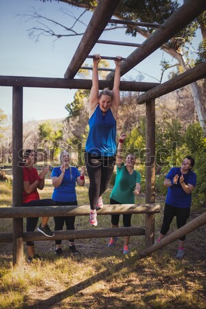 Trainer climbing a rope during obstacle course training Stock photo © wavebreak_media