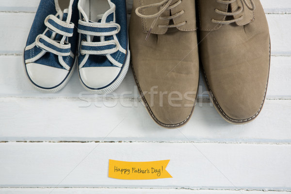 Shoes by text on white table Stock photo © wavebreak_media