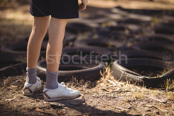 Low section of girl standing near tyre during obstacle course Stock photo © wavebreak_media