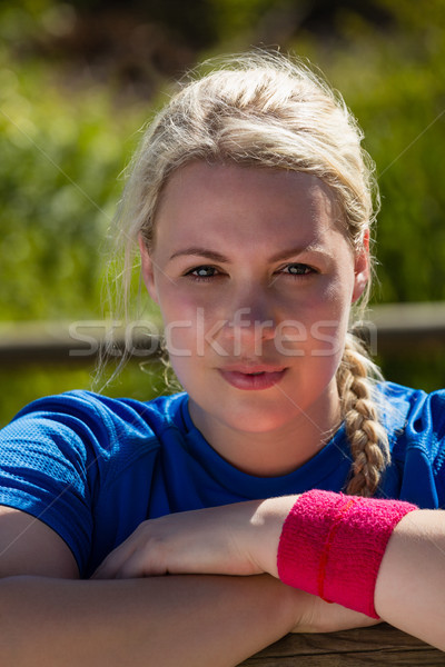 Fit woman leaning on hurdles during obstacle course training in the boot camp Stock photo © wavebreak_media