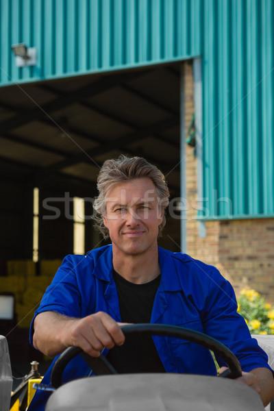 Portrait of worker driving a tractor Stock photo © wavebreak_media