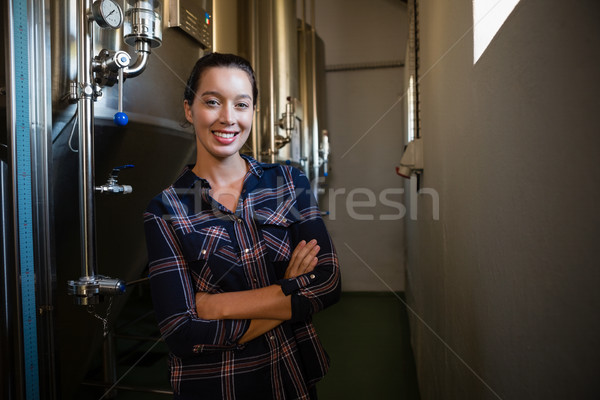 Portrait of confident worker standing by storage tank Stock photo © wavebreak_media