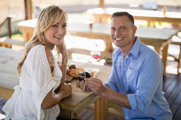 笑みを浮かべて 男 婚約指輪 女性 レストラン ストックフォト © wavebreak_media