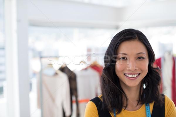 Smiling fashion designer in office Stock photo © wavebreak_media