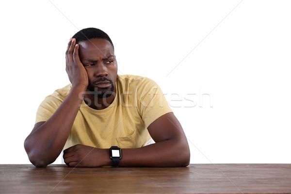 Upset man against white background Stock photo © wavebreak_media