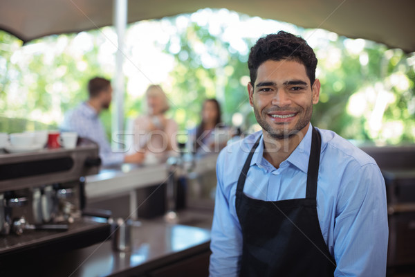 Portrait of smiling waiter at counter Stock photo © wavebreak_media