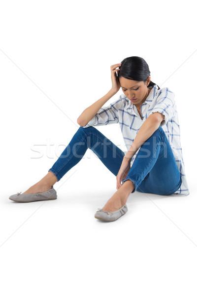 Mujer relajante blanco triste teléfono femenino Foto stock © wavebreak_media
