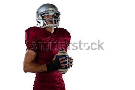 Portrait of sportsman with American football Stock photo © wavebreak_media