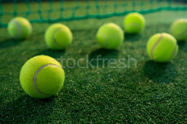 Close up of tennis balls on court Stock photo © wavebreak_media
