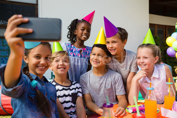 Happy children taking selfie during birthday party Stock photo © wavebreak_media