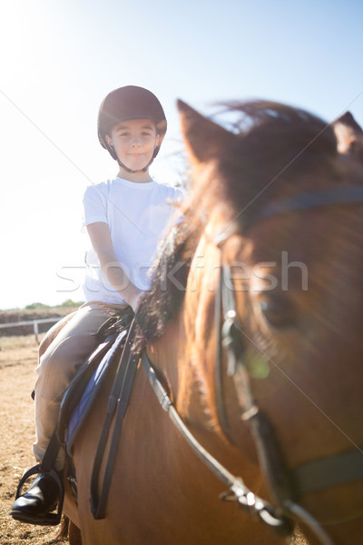 Girl riding a horse in the ranch Stock photo © wavebreak_media