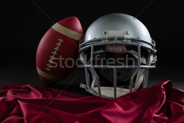 Close-up of American football jersey, head gear and football Stock photo © wavebreak_media