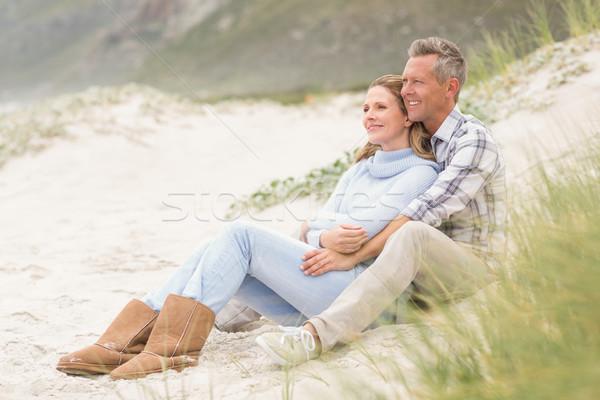Smiling couple sitting together Stock photo © wavebreak_media