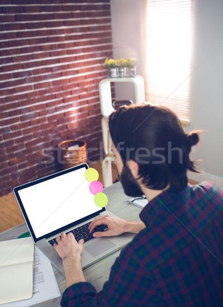 High angle view of creative editor using laptop Stock photo © wavebreak_media