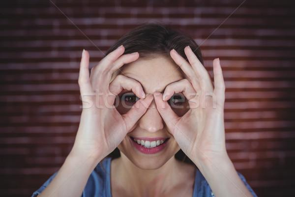 Woman holding hands as binoculars  Stock photo © wavebreak_media