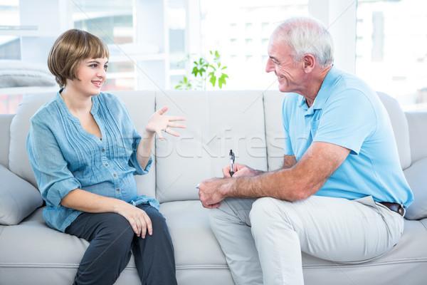 Happy pregnant woman talking to gynaecologist   Stock photo © wavebreak_media