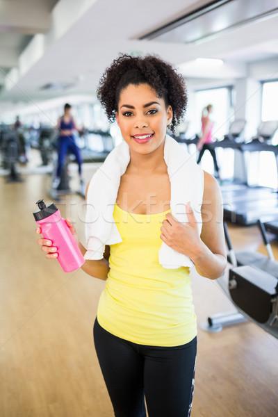 Geschikt vrouw glimlachen camera gymnasium vrouw gelukkig Stockfoto © wavebreak_media