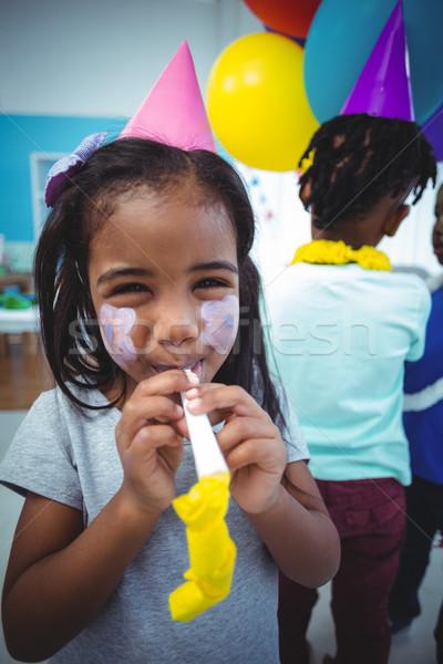 счастливая девушка лице окрашенный празднование дня рождения вечеринка счастливым Сток-фото © wavebreak_media
