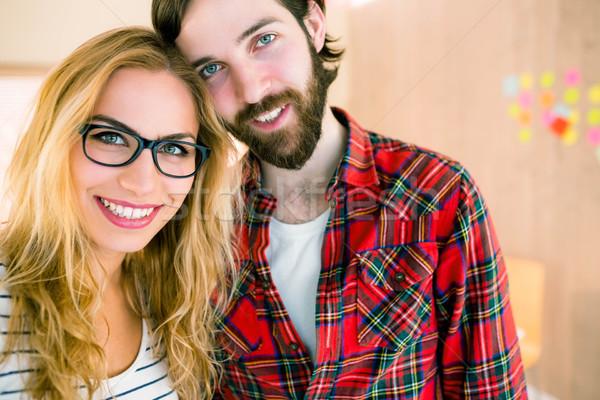 Creativo squadra sorridere fotocamera casuale ufficio Foto d'archivio © wavebreak_media