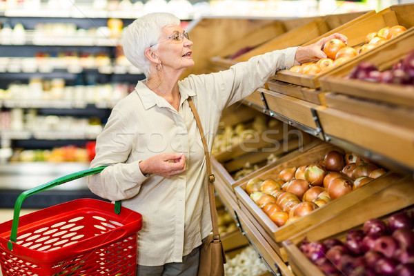 Senior woman picking out some vegetables Stock photo © wavebreak_media