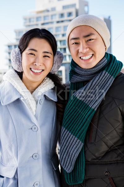 Portrait souriant couple bâtiment ciel homme Photo stock © wavebreak_media