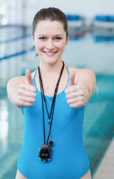 Ziemlich Ausbilder Pool Frau Wasser Stock foto © wavebreak_media
