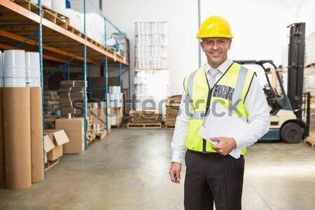 Warehouse worker talking with forklift driver Stock photo © wavebreak_media