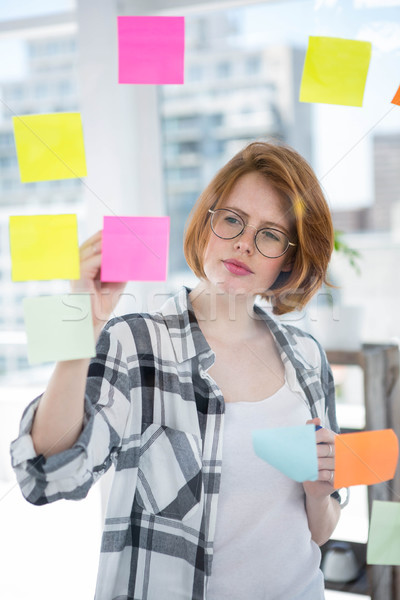 thoughtful hipster woman brainstorming over notes Stock photo © wavebreak_media