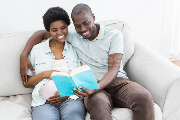 Pregnant couple reading a book Stock photo © wavebreak_media