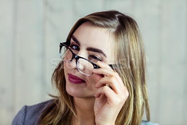 Pretty blonde woman blinking at the camera Stock photo © wavebreak_media