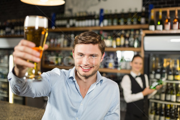 Man toasting a beer Stock photo © wavebreak_media
