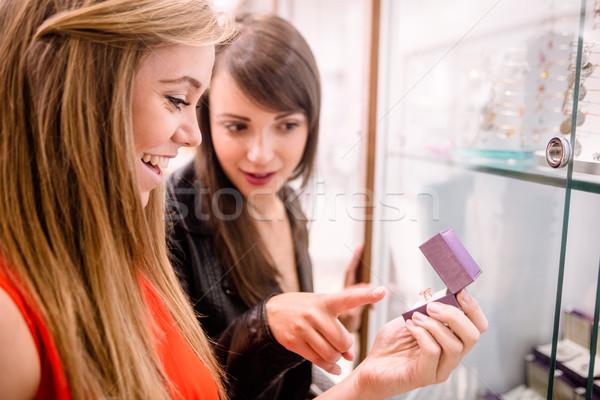 Two beautiful women selecting a finger ring Stock photo © wavebreak_media