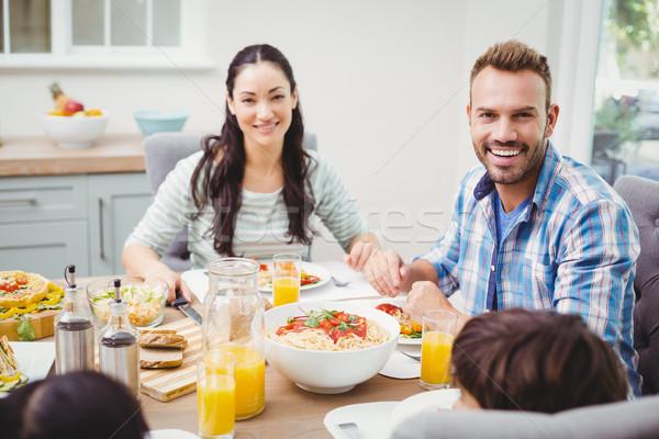 улыбаясь родителей детей сидят обеденный стол портрет Сток-фото © wavebreak_media